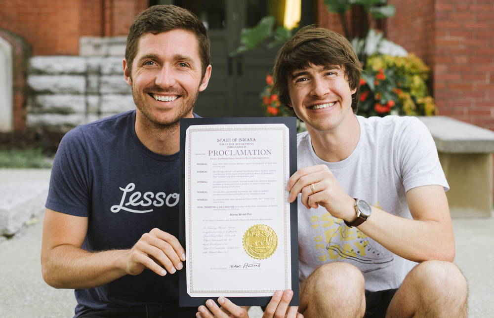 Conner Burt and Max Yoder display the Better Work Week proclamation.