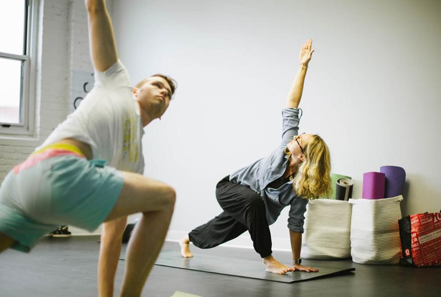 Two people doing yoga.