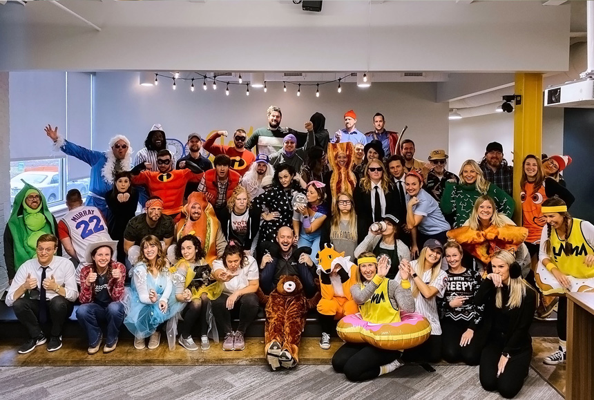 A large group of people dressed up in Halloween costumes.