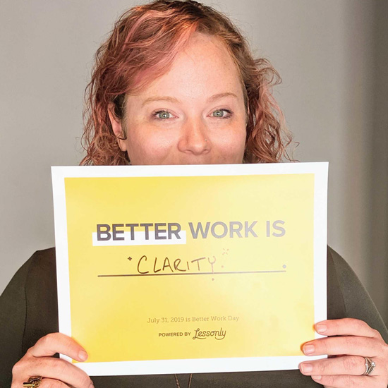 Person showing off a certificate that says what better work means to them.
