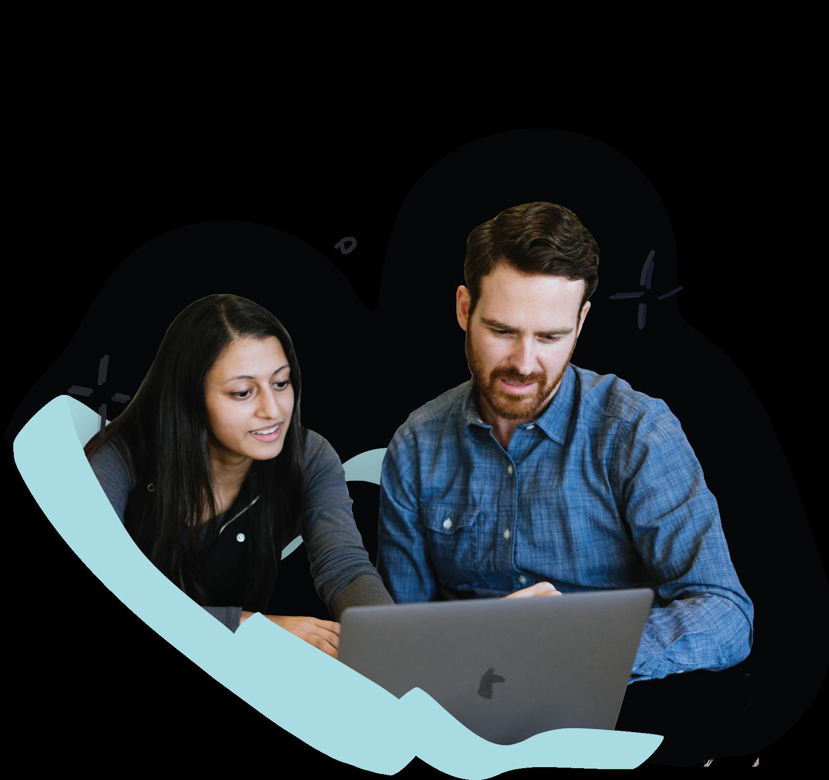 Teammates looking at a shared screen.